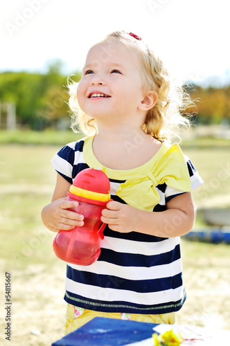 toddler girl with bottle of water