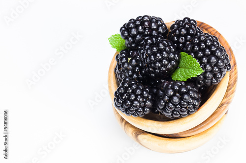 Blackberries. Fresh blackberries in olive wood bowl