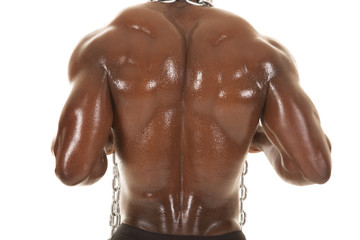 Strong man with chain back close