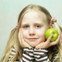 Smiling child and apple