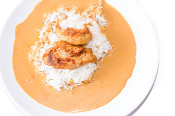 Chicken with pepper sauce with rice.