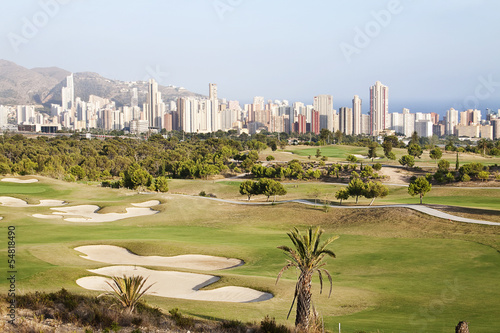 Panoramic of skyscraper city with golf field in Benidorm, Spain