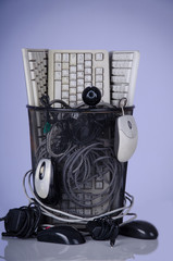 Full trash of used computer keyboards and cables