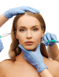woman face and beautician hands with syringe