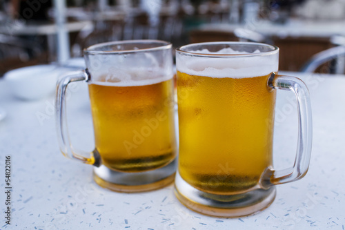 Two mugs of beer