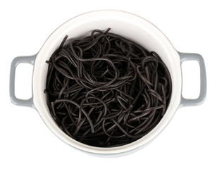Black spaghetti in pan isolated on white