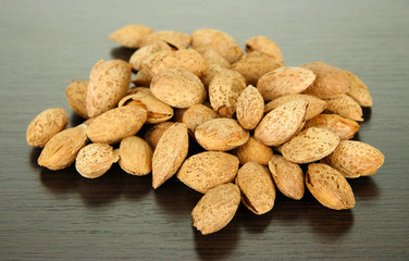 Almond on dark wooden background