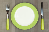 Fototapety Knife, color plate and fork, on color background