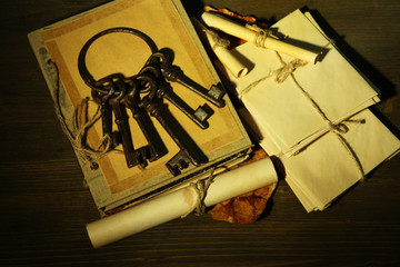Antique keys, letters and book, on dark background
