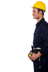 Smiling handyman isolated over white