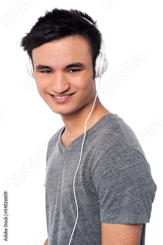 Young guy enjoying music