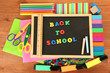 Small chalkboard with school supplies