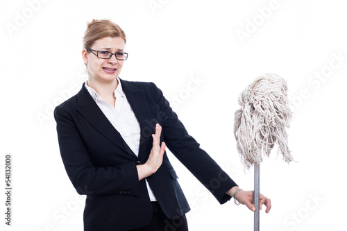 Unhappy businesswoman with mop