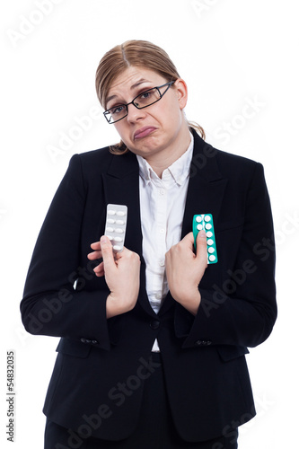 Indecisive woman with pills