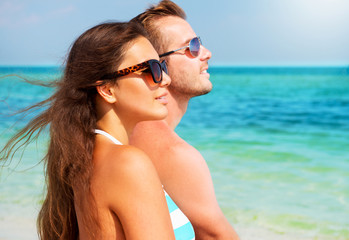 Happy Couple in Sunglasses on the Beach. Summer Vacation