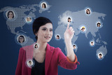 Businesswoman click on digital head on blue