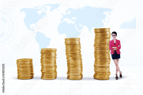 Businesswoman and gold coins chart