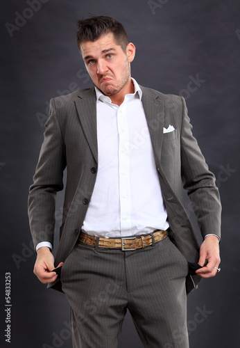 Business man showing his empty pocket