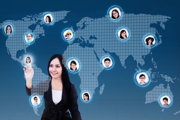 Happy businesswoman click on social network on blue