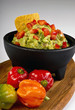 Guacamole and spicy peppers.