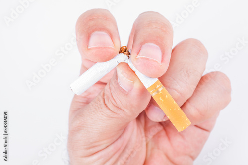 Quit smoking, human hand breaking the cigarette