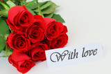 With love card and red roses bouquet