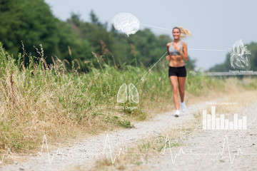 Beautiful blonde woman running along the riverside