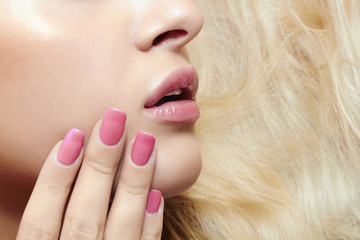 lips,nails and hair of beautiful blond woman