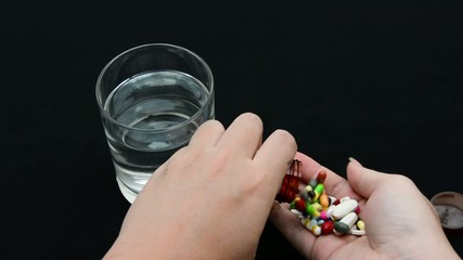 A person is committing suicide by taking over dosage drugs