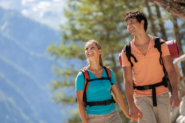 Young couple doing trekking in the mountains