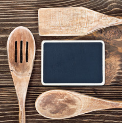 kitchen utensils and a blackboard to write a recipe