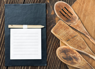 kitchen utensils and a notebook to write a recipe