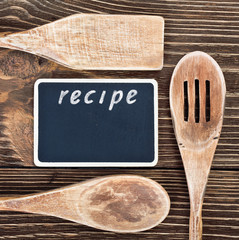 kitchen utensils and a blackboard to write a recipe