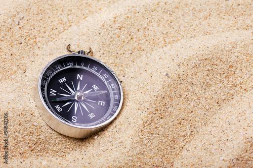 Leinwandbild Motiv compass on the hot sand