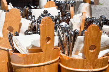 forks, spoons and knives prepared to be served in an outdoor caf