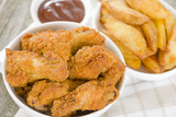 Southern Fried Hot Chicken Wings with bbq sauce & potato wedges