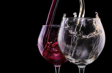 Elegant red wine glass in black background