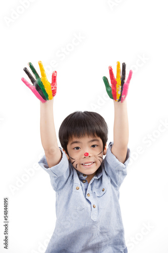 asian boy raise his colorful hands into the sky