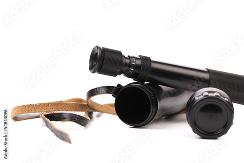 Black cover and spyglass lying