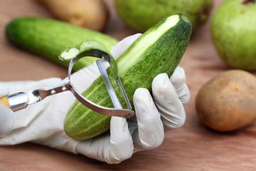 Peeling off the cucumber