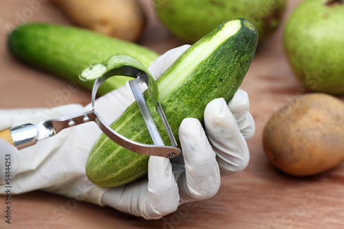Peeling off the cucumber