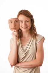 Woman hiding under the happy mask. Hypocritical, insincere, two-