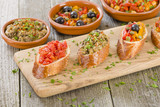 Tapas on Crusty Bread - Spanish tapas on a sliced baguette