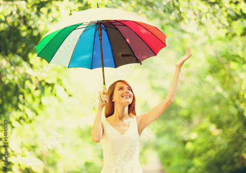 Redhead girl with umbrella at outdoor