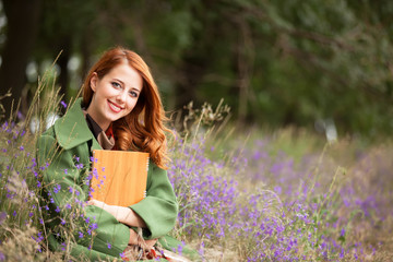 Redhead girl with note at outdoor