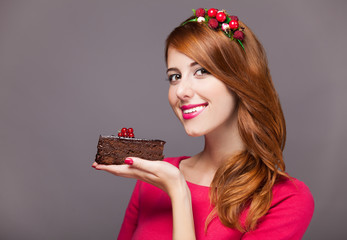Redhead women with berries cake