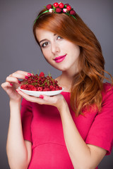 Redhead women with berries