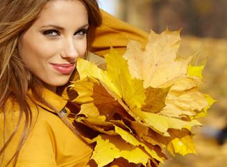 Beautiful autumn woman in golden park