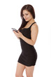 Pretty woman in a little black dress smiles while texting on her