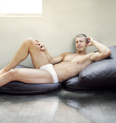 Man lying on pillows